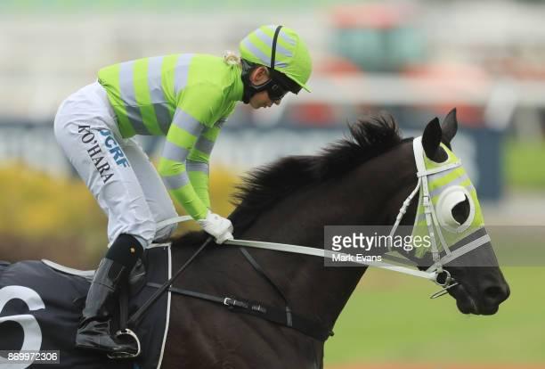 Kathy O'Hara on Black on Gold wins race 4 during Sydney Racing at Rosehill Gardens on November 4 2017 in Sydney Australia