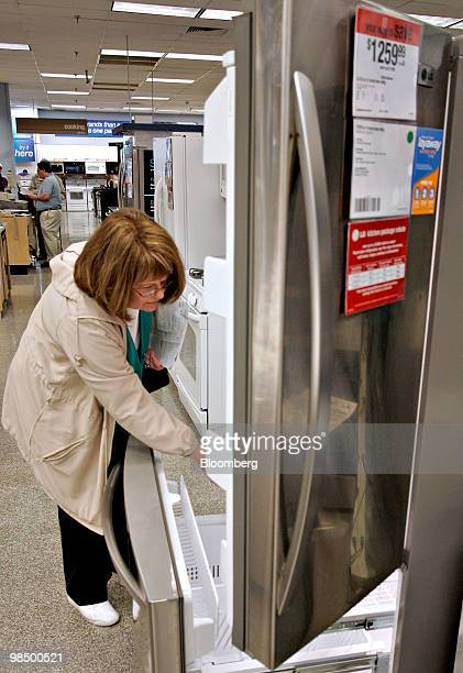 Kathy Patrick of Downers Grove Illinois looks at a Kenmore refrigerator during an Energy Star rebate program for home appliances at a Sears store in...