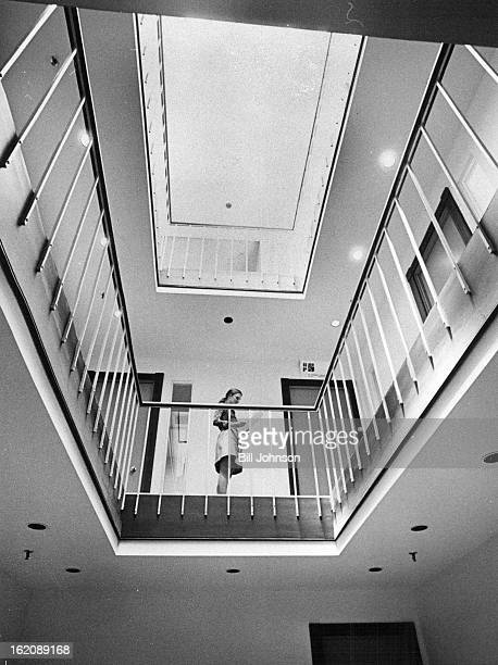 MAY 22 1974 MAY 28 1974 Kathy Renner of Larimer Square Associates stands in the unique atrium at the Buergersussex complex on Larimer Square She rode...