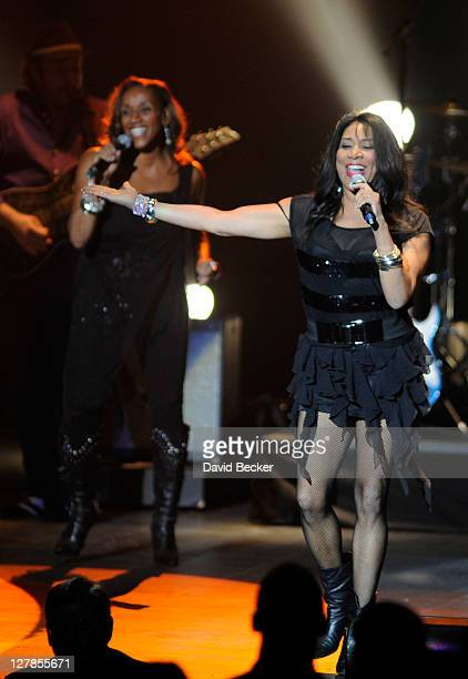 Kathy Sledge and Joni Sledge of Sister Sledge perform at the Justin Timberlake and Friends Old School Jam at the Planet Hollywood Theatre for the...