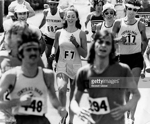 Kathy Switzer of New York makes her way through Ashland Mass while running in the Boston Marathon on April 15 1974