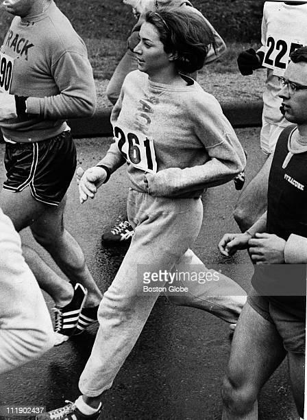Kathy Switzer of Syracuse and Rocky Chamberlain directly behind during the Boston Marathon