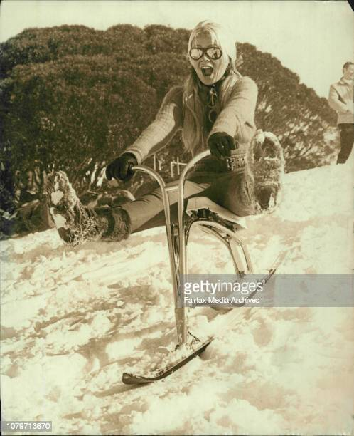 Kathy Troutt of ***** who is working at the Perisher View Motel for the Skiing Season takes off on a Ski BikeKathy was one of the keen spectators at...