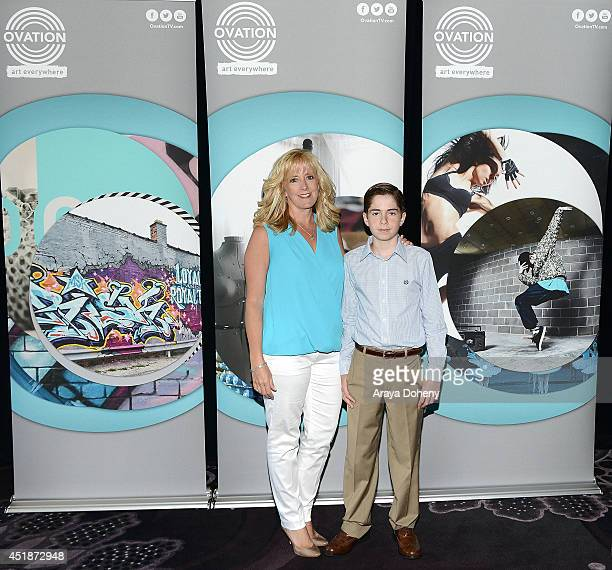Kathy Zandieh and Charlie Zandieh pose backstage for the Ovation TV's 'Young Marvels' panel of the 2014 Summer Television Critics Association at The...