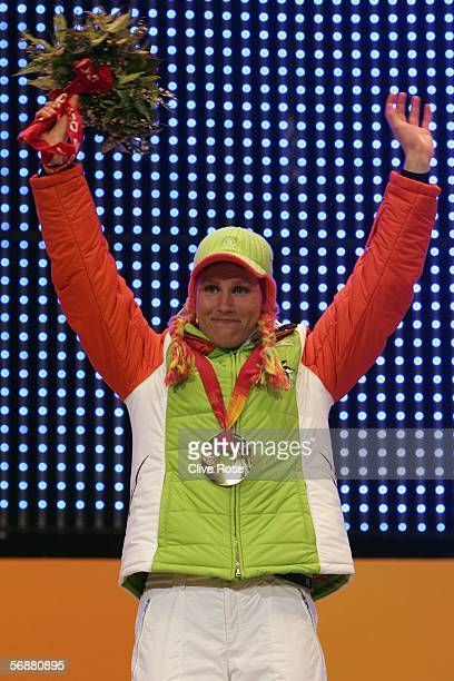 Kati Wilhelm of Germany celebrates receiving her Gold Medal afer her performance in the Biathlon Women's 10km Pursuit during the Medals Ceremony on...