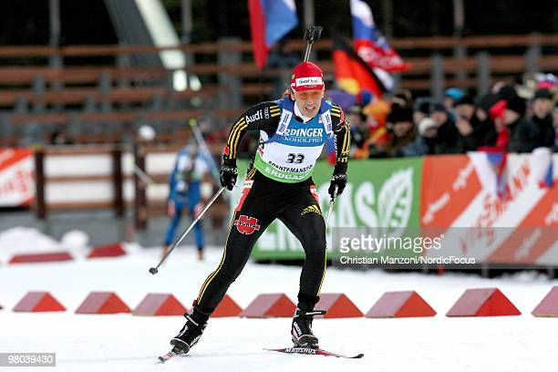 Kati Wilhelm of Germany competes with a Thank you sign on her hat during the women's sprint in the EOn Ruhrgas IBU Biathlon World Cup on March 25...