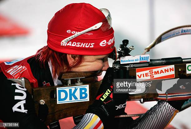 Kati Wilhelm of Germany shoots during the Womens 4 times 6 km relay of the E.ON Ruhrgas IBU Biathlon World Cup on January 03, 2007 in Oberhof near...