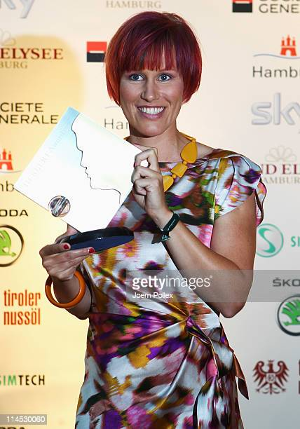Kati Wilhelm presents her award during the Herbert Award 2011 Gala at the Elysee Hotel on May 23 2011 in Hamburg Germany