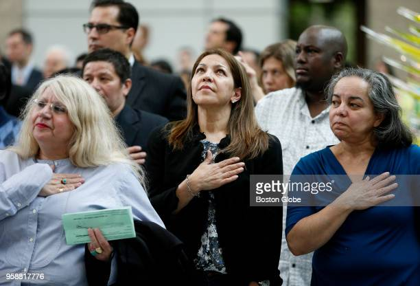 Katia Barroso originally of Brazil center looks up as she says the pledge of allegiance during the first United States naturalization ceremony ever...