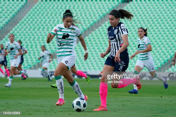 Katia Estrada of Santos fights for the ball with Daniela Solis of Monterrey during a match between Santos and Monterrey as part of the Torneo Grita...