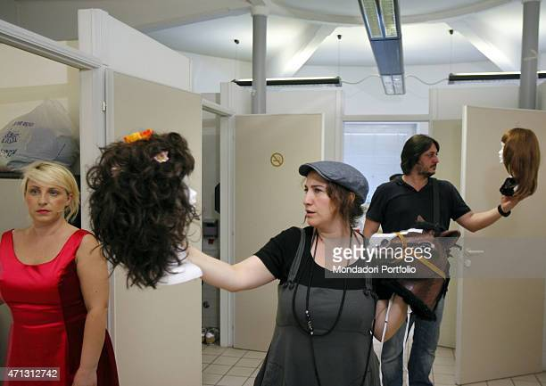 Katia Follesa Maria Di Biase and Alessandro Betti young Italian comic actors known thanks to the tv show Zelig hold some wigs in the dressing room...