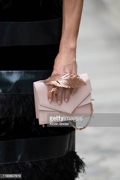 Katia Francesconi handbag detail wears a Ralph and Russo dress and clutch on July 1 2019 in Paris France