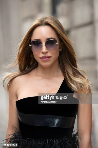 Katia Francesconi wears Pomellato sunglasses and a Ralph and Russo dress on July 01 2019 in Paris France