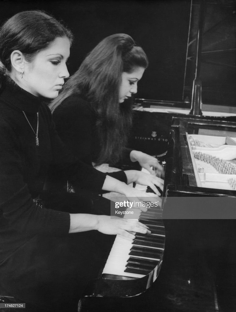 Katia Labeque (left) and Marielle Labeque rehearse at the 'Theatre des Ambassadeurs - Espace Cardin' for a series of concerts titled 'Jeunes Solistes' as part of the 'Musique D'Aujourd Hui' programme, Paris, France, 26th January 1971.