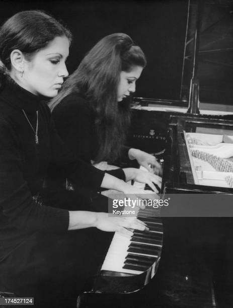 Katia Labeque and Marielle Labeque rehearse at the 'Theatre des Ambassadeurs Espace Cardin' for a series of concerts titled 'Jeunes Solistes' as part...