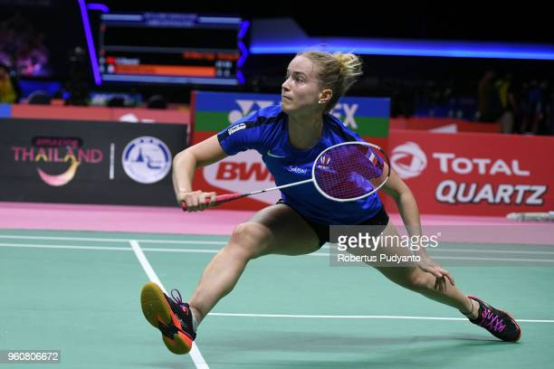 Katia Normand of France competes against Li Xuerui of China during Preliminary Round on day two of the BWF Thomas Uber Cup at Impact Arena on May 21...