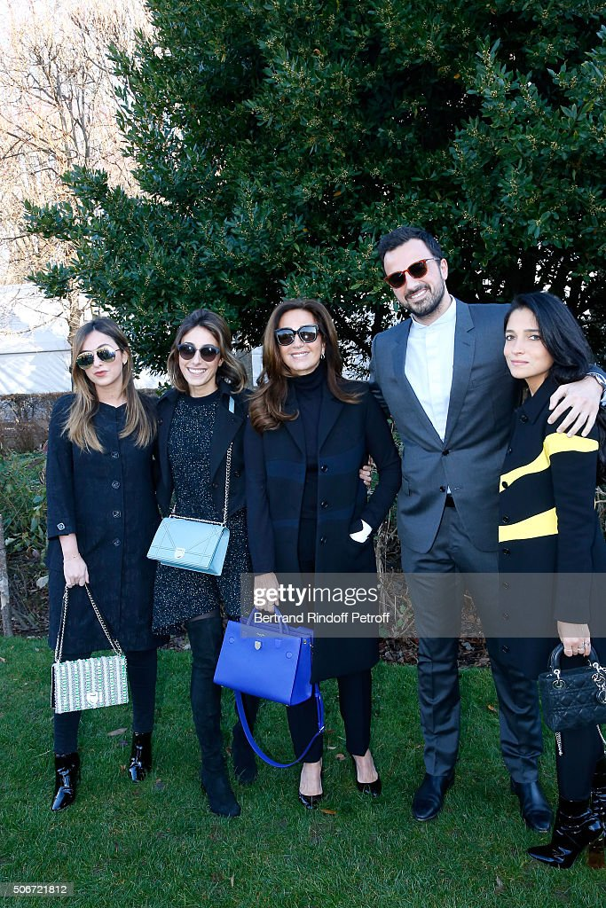 Katia Toledano standing between her daughters Ines (L), Julia (2nd L), her son Alan Toledano (2nd R) and his companion Joy Taieb (R) attend the Christian Dior Spring Summer 2016 show as part of Paris Fashion Week. Held at Musee Rodin on January 25, 2016 in Paris, France.