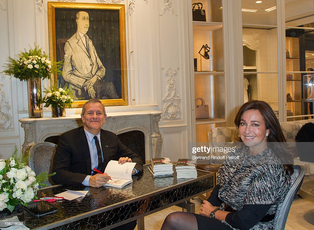 Katia Toledano, the wife of Sidney Toledano, CEO of Christian Dior (R) and Francis Huster attend the signing of Huster's book 'And Dior Created Woman' at Dior Boutique on November 19, 2012 in Paris, France.