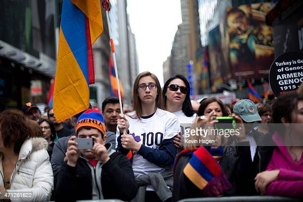 Katiana Sarkissian with her mother Nadine holds an Armenian flag during a rally to commemorate the 1915 Turkish massacre of Armenians in Times Square...