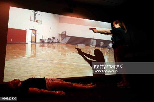 TOPSHOT Katie an elementary school teacher in Jefferson County Colorado takes part in a simulated active shooter drill during a three day firearms...