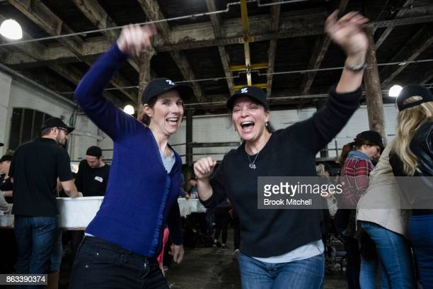 Katie Arighov and Pavlina Marias get in the spirit during Zambrero's meal packing day on October 20 2017 in Sydney Australia More than 1700...