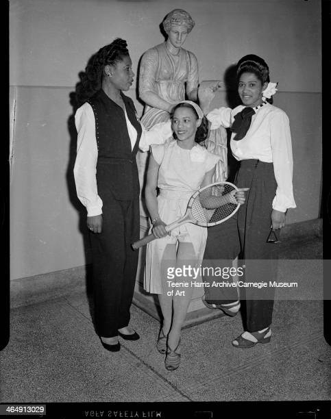 Katie B Miller Virginia Wooling holding tennis racket and Leola Howard modeling sportswear for Beauty Shop Owners' Fashion Revue at Schenley High...
