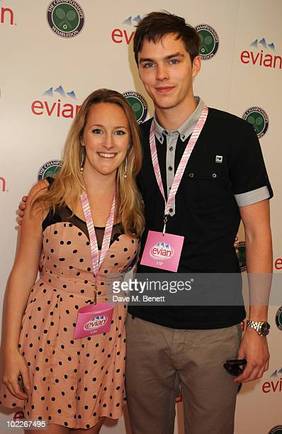 Katie Banks and Nicholas Hoult attend the Evian VIP Suite during the 2010 Wimbledon Championships at the All England Tennis Club on June 21 2010 in...