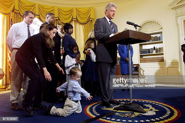 Katie Banks reaches for her son Collin who's not paying much attention to President Bill Clinton in the Oval Office Collin's father Eric and members...