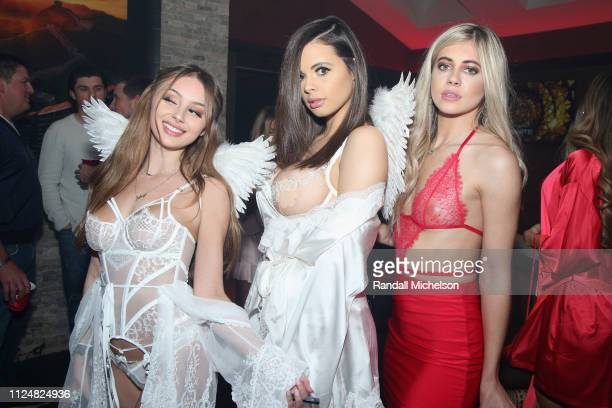 Katie Bell and guests attend Ignite's Angels and Devils Pre-Valentine's Day Party on February 13, 2019 in Bel Air, California.