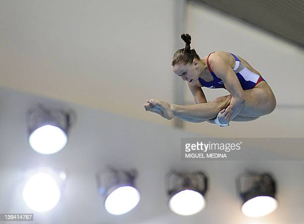 Katie Bell competes during the women's 10m Platform Diving World Cup 2012 event, at the Olympic Aquatic in east London, on February 20, 2012. AFP...