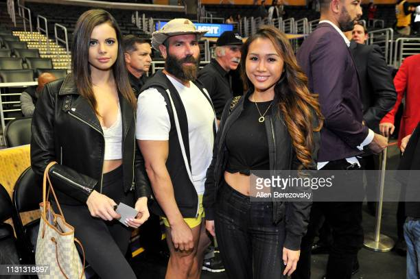 Katie Bell Dan Bilzerian and Kathryn Le attend a basketball game between the Los Angeles Lakers and the Houston Rockets at Staples Center on February...