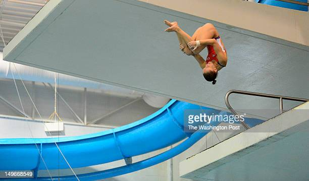Katie Bell perform s a dive from the three meter platform as the US Olympic Diving Team trains at the Eunice Kennedy and Sargent Shriver Aquatic...
