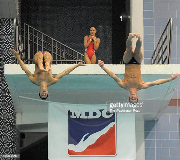 Katie Bell waits her turn on the three meter platform while Nick McCrory and David Boudia perform a synchro dive as the US Olympic Diving Team trains...