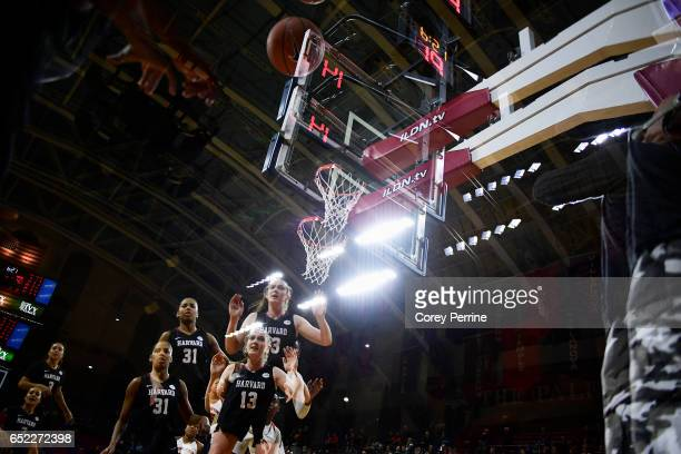 Katie Benzan, Taylor Rooks and Jeannie Boehm of the Harvard Crimson watch a ball bounce out of bounds against the Princeton Tigers during the fourth...
