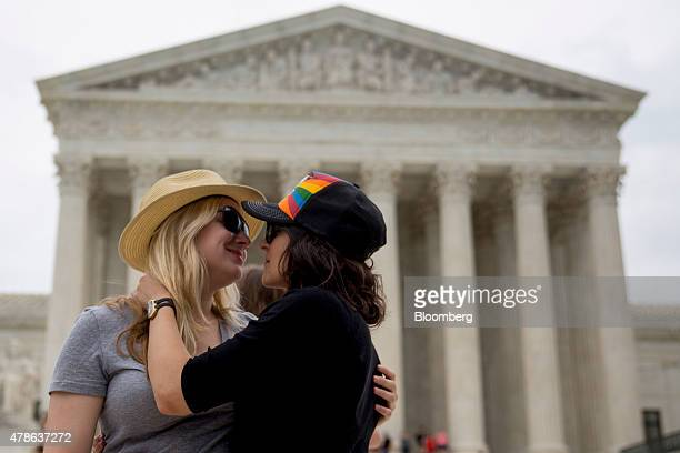 Katie Boothroyd left embraces her girlfriend of one and a half years on the steps outside the US Supreme Court after the samesex marriage ruling in...