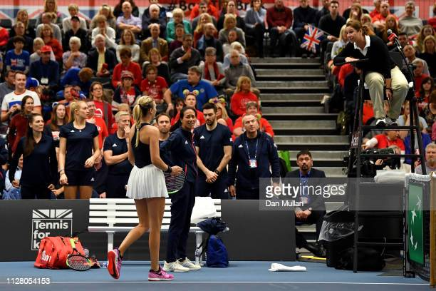 Katie Boulter and Anne Keothavong of Great Britain talk to the match referee after a dubious line call during her Europe/Africa Group A match against...