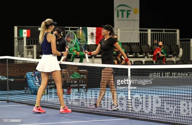Katie Boulter of Great Britain and Giuliana Olmos of Mexico tap rackets after match four during day two of the Billie Jean King Cup Play-Offs between...