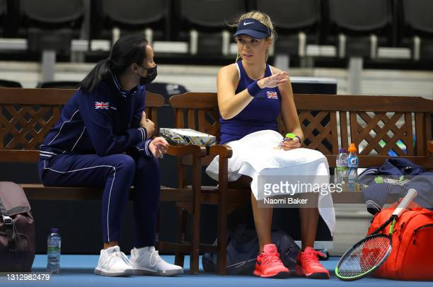 Katie Boulter of Great Britain and Great Britain's captain Anne Keothavong chat between games during match four between Katie Boulter of Great...