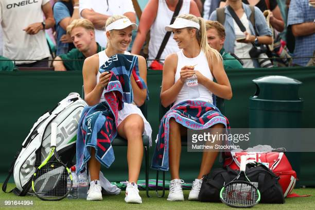 Katie Boulter of Great Britain and Katie Swan of Great Britain talk during a break in play in their Ladies' Doubles second round match against Lucie...