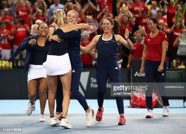 Katie Boulter of Great Britain celebrates defeating Zarina Diyas of Kazakhstan with team mates as they won the tie during the Fed Cup World Group II...