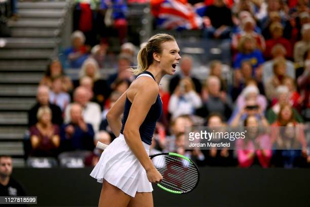 Katie Boulter of Great Britain celebrates victory during her round robin match against Kaja Juvan of Slovenia on Day One of the Fed Cup at University...