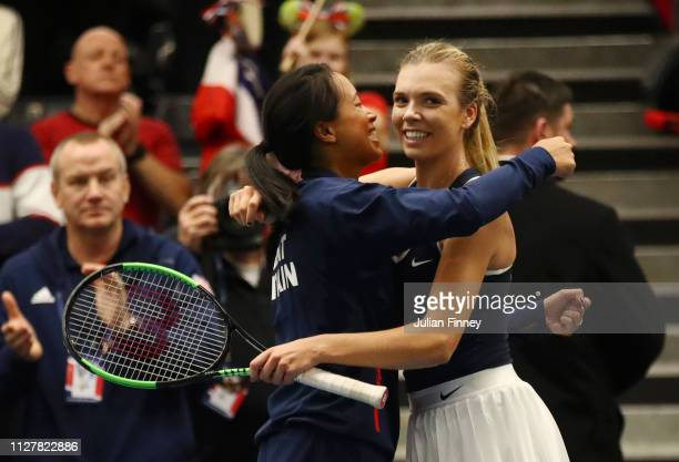 Katie Boulter of Great Britain celebrates with captain Anne Keothavong after winning her round robin match against Kaja Juvan of Slovenia during Day...