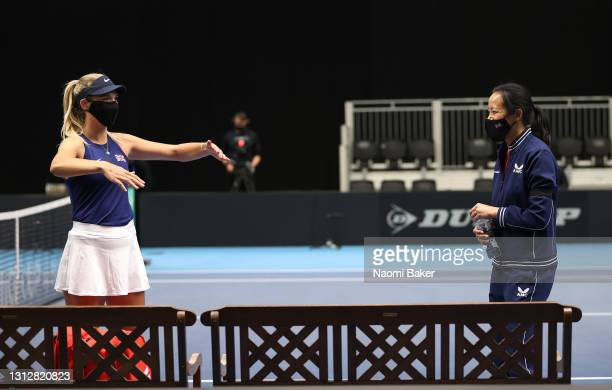 Katie Boulter of Great Britain gives Great Britain's captain Anne Keothavong an air hug after winning match one between Katie Boulter of Great...