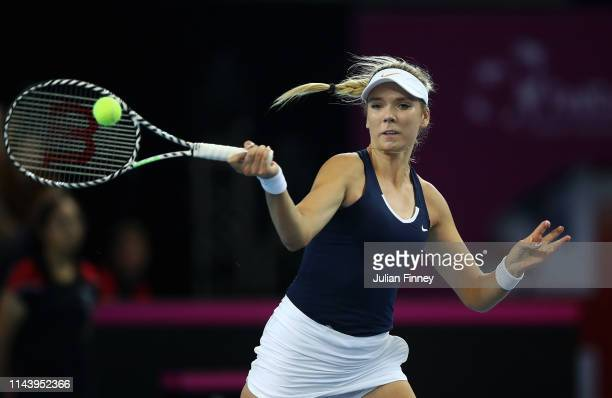 Katie Boulter of Great Britain in action against Yulia Putintseva of Kazakhstan during the Fed Cup World Group II Play-Off match between Great...