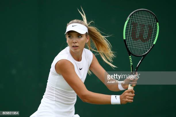 Katie Boulter of Great Britain plays a forehand during the Ladies Doubles first round match with Katie Swan of Great Britain against Timea Babos of...