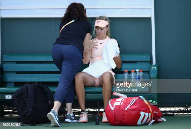 Katie Boulter of Great Britain receives treatment against SuWei Hsieh of Taipei in their first round match during the Miami Open Presented by Itau at...