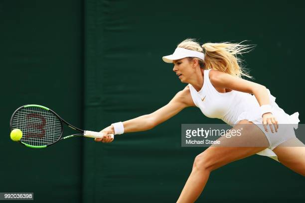 Katie Boulter of Great Britain returns a shot against Naomi Osaka of Japan during their Ladies' Singles second round match on day four of the...