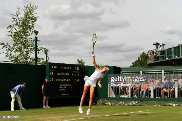 Katie Boulter of Great Britain serves during the Ladies Singles first round match against Christina McHale of The United States on day two of the...