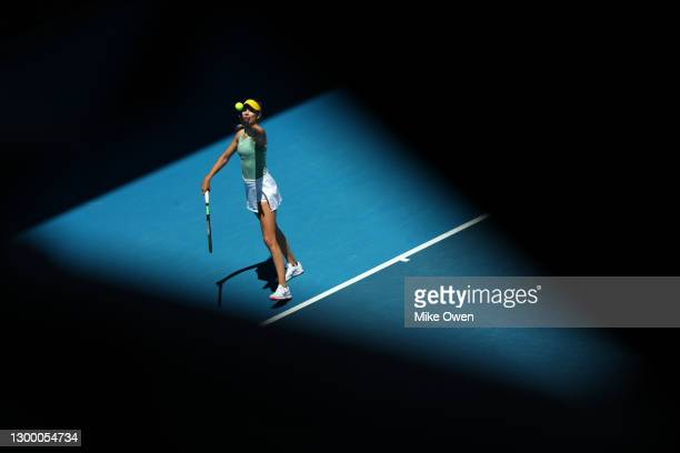 Katie Boulter of Great Britain serves in her match against Naomi Osaka of Japan during day four of the WTA 500 Gippsland Trophy at Melbourne Park on...