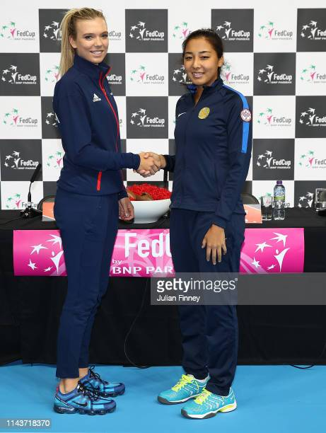 Katie Boulter of Great Britain shakes hands with her second opponent Zarina Diyas of Kazakhstan prior to the Fed Cup World Group II Play-Off match...